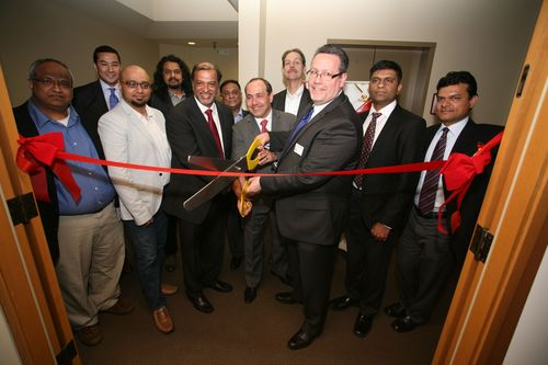 City Council President Hank Margeson cuts the ribbon to inaugurate Sonata US Office and Delivery Center-Redmond, accompanied by Sonata MD & CEO Srikar Reddy (PRNewsFoto/Sonata Software Ltd)