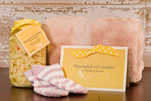 Spoonful of Comfort's Flu Fighter Package includes chicken noodle soup, a plush blanket and cozy socks.  (PRNewsFoto/Spoonful of Comfort)