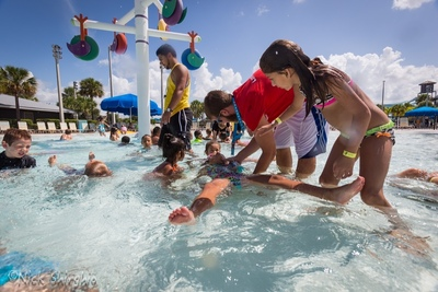 Lifeguard Matt Coakley at Sun & Fun Lagoon in Naples FL. instructs one of more than 37,000 swimmers on six continents learning the back float as part of today's World's Largest Swimming Lesson event. (PRNewsFoto/World's Largest Swimming Lesson)