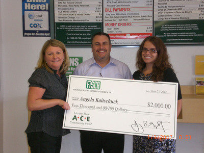 ACE's Region VP, Kim Montgomery, with FiSCA scholarship winner, Angela Kaitschuck, and her father.  (PRNewsFoto/ACE Cash Express, Inc.)