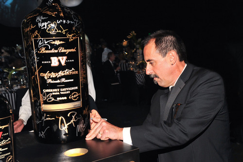Beaulieu Vineyard Director of Winemaking Jeffrey Stambor puts the final signature on the exclusive celebrity autographed 27L Georges de Latour, benefitting the ATAS Foundation.  Bid online at www.CharityBuzz.com.  (PRNewsFoto/Beaulieu Vineyard, Vince Bucci)