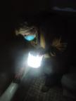 A woman uses Luci during Hurricane Sandy.  (PRNewsFoto/Digital Firefly Marketing)