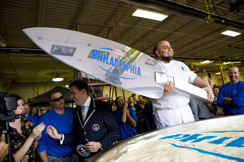 Celebrity Chef Duff Goldman Serves First Slice of PHILADELPHIA Cream Cheese's GUINNESS WORLD RECORDS(R) Largest Cheesecake to Crowd at Cream Cheese Festival in Lowville, New York.  (PRNewsFoto/PHILADELPHIA Cream Cheese)