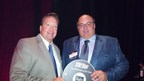 Vice President of Franchise Operations and Marketing Alan Wright and President/CEO and Cofounder Chris Newcomb accepting at the Fast Casual awards.