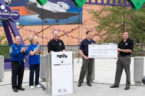 Michael Rouse presents a donation to California ScienCenter. (PRNewsFoto/Toyota)