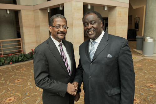 Edison Electric Institute Executive V.P. David Owens greets Steven Hightower Chairman of HP Energy.  (PRNewsFoto/Edison Electric Institute)