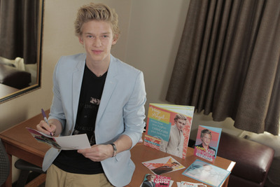 Cody Simpson signs new Hallmark greeting for a special fan.