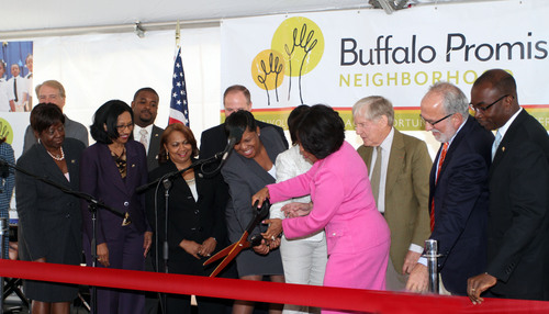 M&T Bank Chairman and CEO Robert G. Wilmers (3rd from right) joins Buffalo Mayor Byron Brown (far right) and a ...
