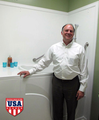 Tony Long pictured alongside one of Premier's bestselling walk in baths.  (PRNewsFoto/Premier Care in Bathing)