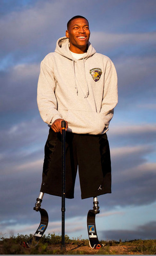 U.S. Marine Corps Corporal Anthony McDaniel lost both his legs and his left hand to an improvised explosive ...