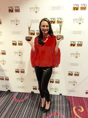Amber Olson Rourke, CMO of Nerium International, accepts seven Stevie Awards for Women in Business