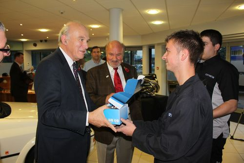 Secretary of State, Vince Cable - who visited Cosworth today to show his support for the company's plans to create a new factory - is presented with an engraved Formula One piston by Cosworth apprentices, Charlie Bailey and Toby Hibble. From L - R: The RT Hon Dr. Vince Cable MP, Kevin Kalkoven (chairman, Cosworth), Charlie Bailey (apprentice, Cosworth), Toby Hibble (apprentice, Cosworth)