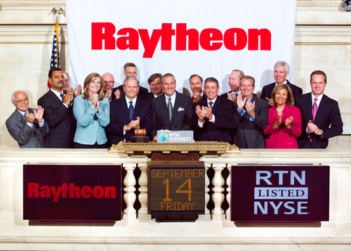 Closing Bell: Raytheon Company Chairman and CEO William H. Swanson (center), joined by company leaders, rings the closing bell of the New York Stock Exchange, Sept. 14, 2012, marking the company's 60th year of trading. Photo: New York Stock Exchange.  (PRNewsFoto/Raytheon Company, New York Stock Exchange)