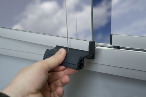 The revolutionary opening of Lumon balcony glazing system can be used with one hand which makes it easy to use. (PRNewsFoto/Lumon International Oy)