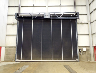 Powerhouse industrial rubber door from Rytec Corporation shown on wash building for heavy equipment.  (PRNewsFoto/Rytec Corporation)
