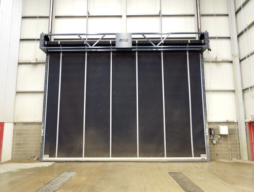 Powerhouse industrial rubber door from Rytec Corporation shown on wash building for heavy equipment.  ...
