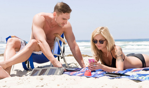 Portable solar charger at the Beach. (PRNewsFoto/StrongVolt) (PRNewsFoto/STRONGVOLT)
