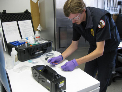 An FDA investigator prepares a dietary supplement sample for analysis by an ion mobility spectrometer at the Port of Buffalo in Buffalo, N.Y. FDA is using high-tech devices to detect contamination of some products.
