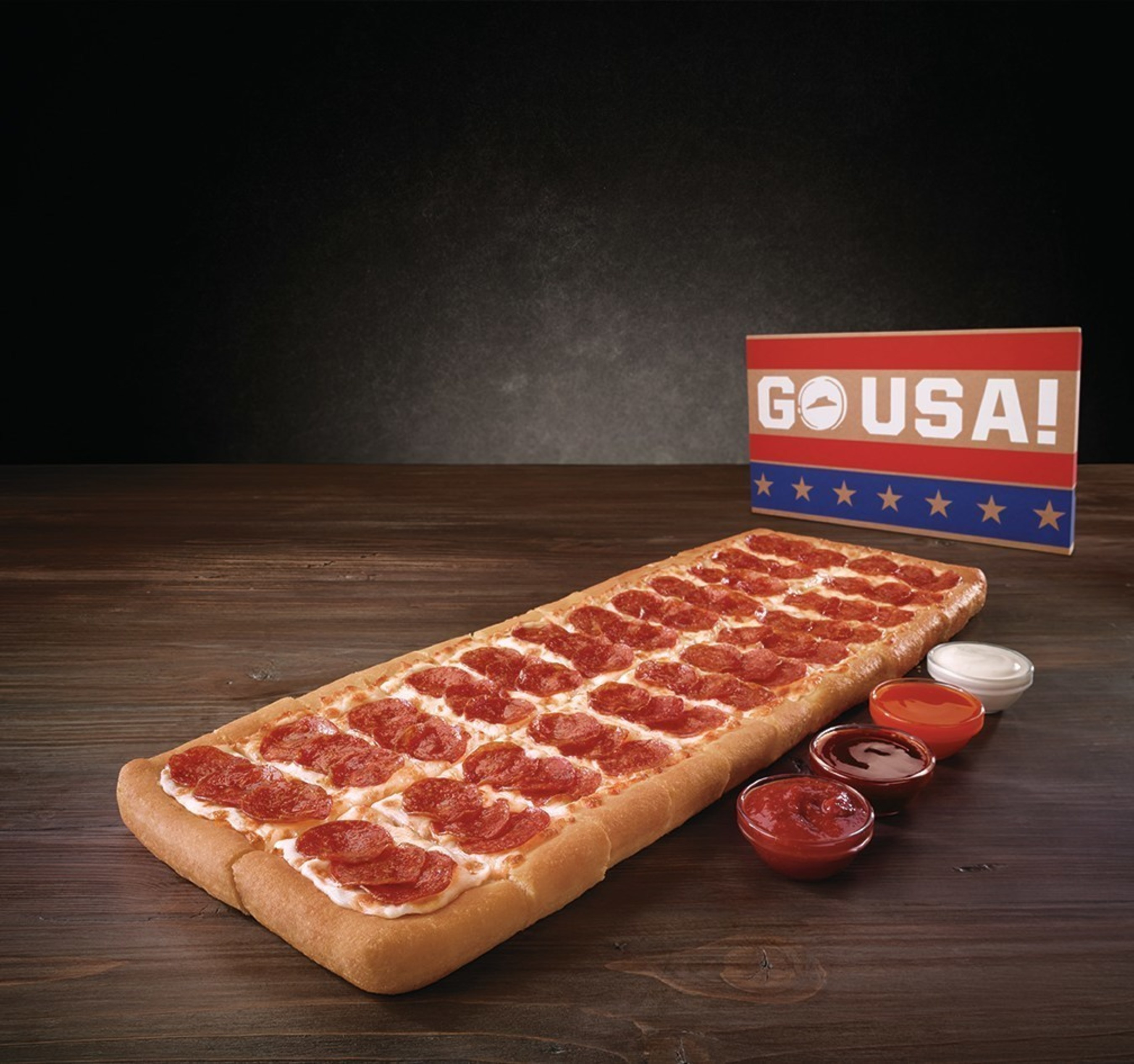 Pizza Hut will please crowds this summer with the Big Flavor Dipper Pizza, a pizza that is nearly two-feet long and features U.S.-inspired sauces - all served in a patriotic box - for only $12.99.