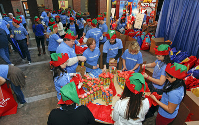 Hasbro employees spread cheer to children worldwide on second annual Global Day of Joy on Dec. 4 (PRNewsFoto/Hasbro Inc.)