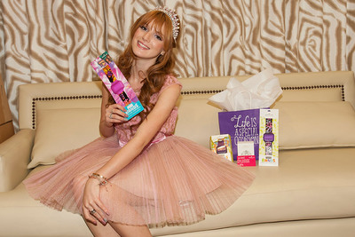 """Shake It Up!"" star Bella Thorne shows off the newly licensed ""Shake It Up!"" style band from Hallmark. Bella gave Hallmark Text Bands as party favor to friends who attended her Quinceanera."