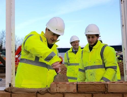 George Osborne, Jeff Fairburn (CEO Persimmon) and James Doyle (Persimmon apprentice) (PRNewsFoto/Persimmon Homes) (PRNewsFoto/Persimmon Homes)