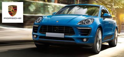 Porsche's first compact crossover, the 2015 Porsche Macan, made its Loeber Motors debut this week. (PRNewsFoto/Loeber Motors)