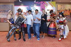 Group photo of cosplayers with MDeC CEO Dato' Yasmin Mahmood (third from left), MDeC's Director of Creative Multimedia Division Mr. Hasnul Hadi Samsudin (fourth from left) and Gamefounders Co-founder & CEO Ms. Kadri Ugand (third from right) striking a battle pose.