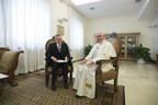 Francesco Sisci sitting with Pope Francis at the Vatican; Photo courtesy of the Vatican.