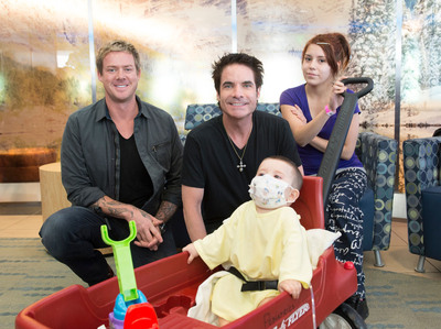 Members of the Grammy-award winning group, Train, visit with Denver Health patient, Elijah (1 year old) and his mother, Devonie before performing at the hospital's annual gala.  (PRNewsFoto/Denver Health)