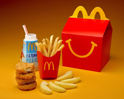 "McDonald's USA president Jan Fields announces the company's ""Commitments to Offer Improved Nutrition Choices,"" including a new Happy Meal set to roll out in September 2011. The new Happy Meal will automatically include both produce (apple slices) and a new smaller size French fries (1.1 ounces) and a choice of beverage, including new fat-free chocolate milk and 1% low fat white milk.  (PRNewsFoto/McDonald's USA, LLC, Bill Parrish Photography)"