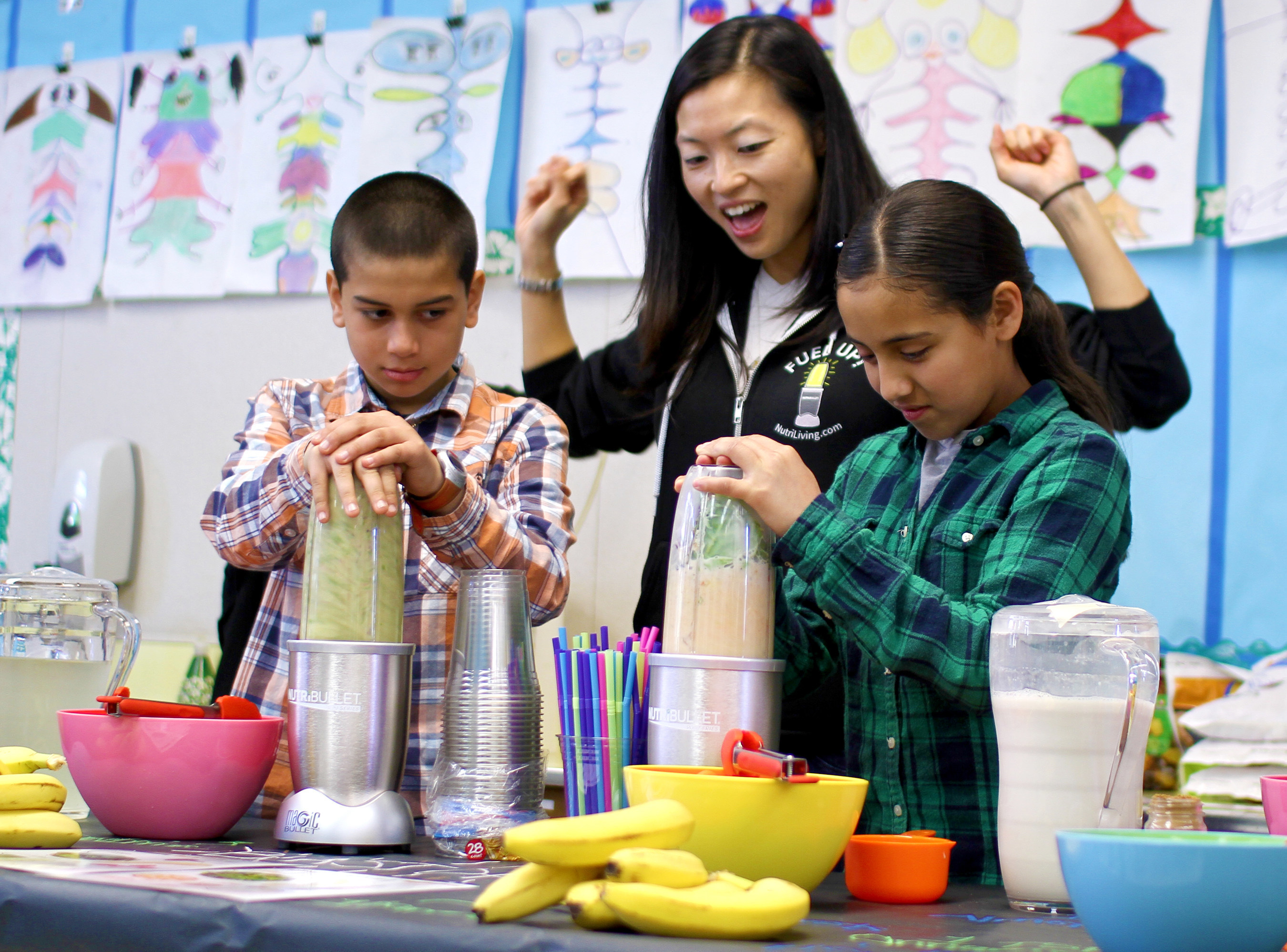 NutriBullet dietitian Gigi Kwok works with students at El Verano Elementary in Sonoma, Calif. as part of the ...