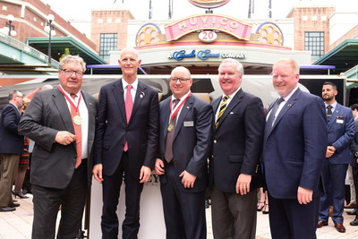 Left to Right - for your reference - is: Governor Rick Scott (State of Florida), Ron Wanek (Founder and Chairman of Ashley Furniture Industries), Mark Dufresne (CEO of Ashley Global Retail), Todd Wanek (President & CEO of Ashley Furniture Industries), Mayor Bob Buckhorn (City of Tampa)