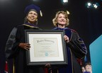 Dr. Condoleezza Rice is presented an honorary Doctor of Humane Letters, honoris causa degree, from Walden University by its president, Dr. Cynthia Baum (PRNewsFoto/Walden University)