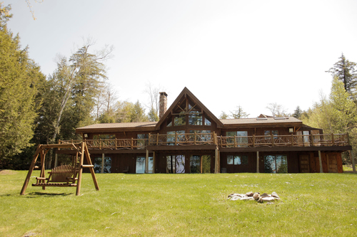 Up for Auction: A rare privately-owned waterfront property located at 50 Lower Saranac Road on Saranac Lake in ...