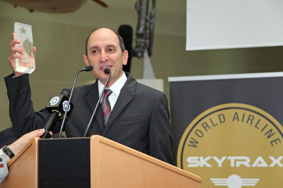 Qatar Airways Chief Executive Officer Akbar Al Baker celebrating an historic moment as the carrier is named Airline of the Year at the annual Skytrax World Airline Awards 2011 held during the Paris Air Show.  (PRNewsFoto/Qatar Airways)