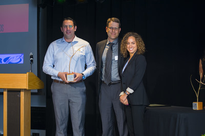 VWR associates Luke Denly (left) and Sepee Cigarchi (right) accepted the 2016 Sustainability Award for Outstanding Campus Vendor from Ted Johnson, Chief Procurement Officer for the University of California San Diego.