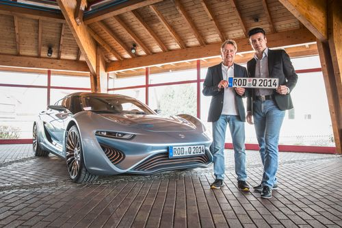 The QUANT e-Sportlimousine with nanoFLOWCELL® drivetrain concept has been officially approved by TÜV Süd in Munich for use on public roads in Germany and Europe after in-depth inspection. Nunzio La Vecchia, chief technical officer at nanoFLOWCELL AG, and Prof. Jens-Peter Ellermann, chairman of the board of directors at nanoFLOWCELL AG, were handed the official registration plate with number ROD-Q-2014. (PRNewsFoto/nanoFLOWCELL AG)