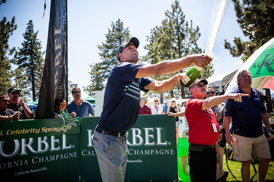 Miami Heat forward and recent NBA Finals Champion Shane Battier pops the cork to win the seventh annual Korbel Celebrity Spray-Off in Lake Tahoe on July 18, 2013.  (PRNewsFoto/Korbel)