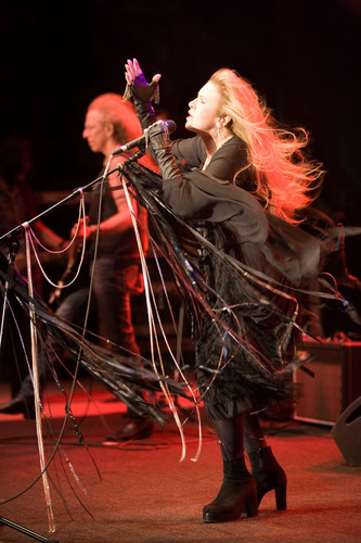 (l. to r.) Musician Waddy Wachtel and Stevie Nicks perform in midst of windstorm at American Thunder Benefit ...