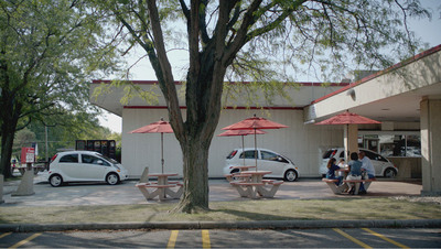 Drive-thru scene from the 2012 Mitsubishi i new TV Ad campaign.  (PRNewsFoto/Mitsubishi Motors North America, Inc.)