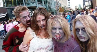 Denverites love any excuse to put on a costume! The largest zombie gathering in history will take place in downtown Denver on Saturday, October 19 when some 16,000-plus blood splattered crazies drag themselves down the 16th Street Mall in a day-long event that can be as funny as it is horrifying. Photo Credit: Rich Grant.  (PRNewsFoto/VISIT DENVER, The Convention & Visitors Bureau)