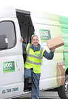 Dublin Postwoman with one of the An Post postal delivery vehicles in which the Fleetmatics solution will be fitted.