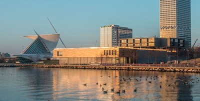 The renovated Milwaukee Art Museum on the shore of Lake Michigan is captured at sunrise.