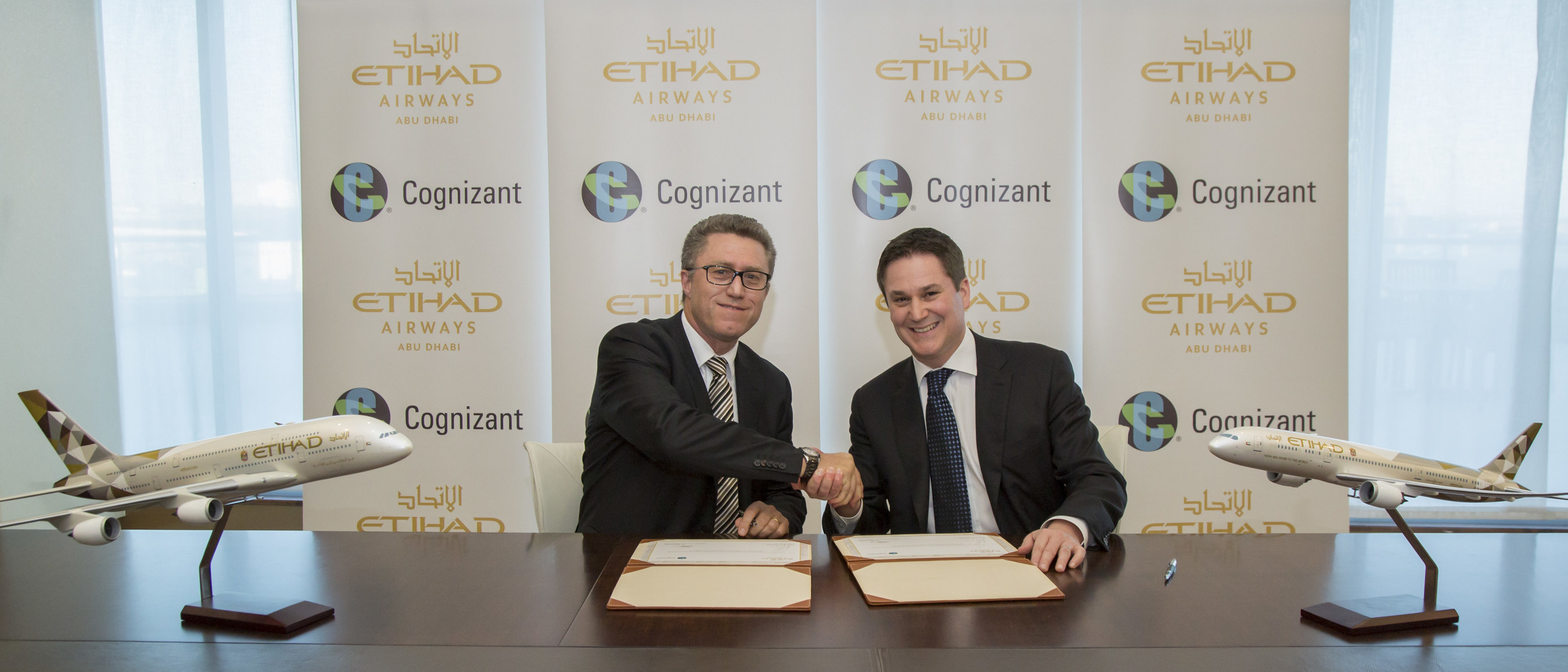 Dr. John Burgin, Head of Cognizant Digital Works, APAC and Middle East (left) and Peter Baumgartner, Etihad Airways' Chief Commercial Officer, sign the strategic agreement between Etihad Airways and Cognizant.