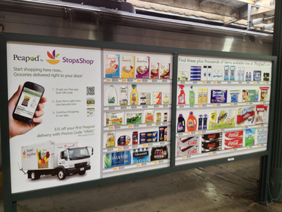 Peapod.com launches virtual grocery stores at more than 100 train stations from Boston to D.C. and in Chicago.  Commuters can scan and shop for groceries with their smartphones at billboards like this one on a platform in Hoboken, N.J.  (PRNewsFoto/Peapod)