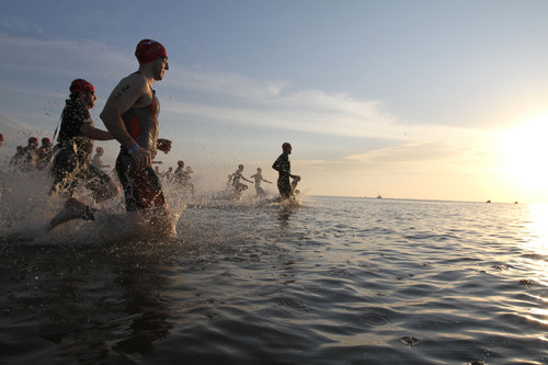 Early morning 1,500-meter swim signals the start of annual Turtle Crawl Triathlon and NestFest, a family oriented fundraising event celebrating the launch of sea turtle nesting season on Jekyll Island.  This year's three-race Turtle Crawl series, on May 17, 2014, will consist of two triathlons for elite athletes and a 5K run.  The accompanying NestFest educational activities include the release back into the Atlantic Ocean of a sea turtle recently rehabilitated at Jekyll Island's renowned Georgia Sea Turtle Center.  (PRNewsFoto/Jekyll ...