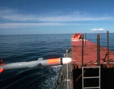 A synthetically guided Tomahawk cruise missile successfully hits a moving maritime target Jan. 27 after being launched from USS Kidd (DDG 100) near San Nicolas Island in California. The missile altered its course toward the target after receiving position updates from surveillance aircraft. (U.S. Navy photo)