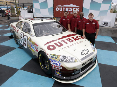Outback Steakhouse announces sponsorship with Stewart-Haas Racing and Ryan Newman for 2012 NASCAR Season. Seen here (Left to Right): Tony Stewart, Ryan Newman, Desmond Edwards and Mike Kappitt.  (PRNewsFoto/Outback Steakhouse, CIA Stock Photography)