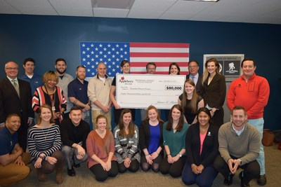 The Applebee's team presents the check to Wounded Warrior Project team.
